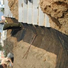 Preparació de la base per la cuneta de terres i herba